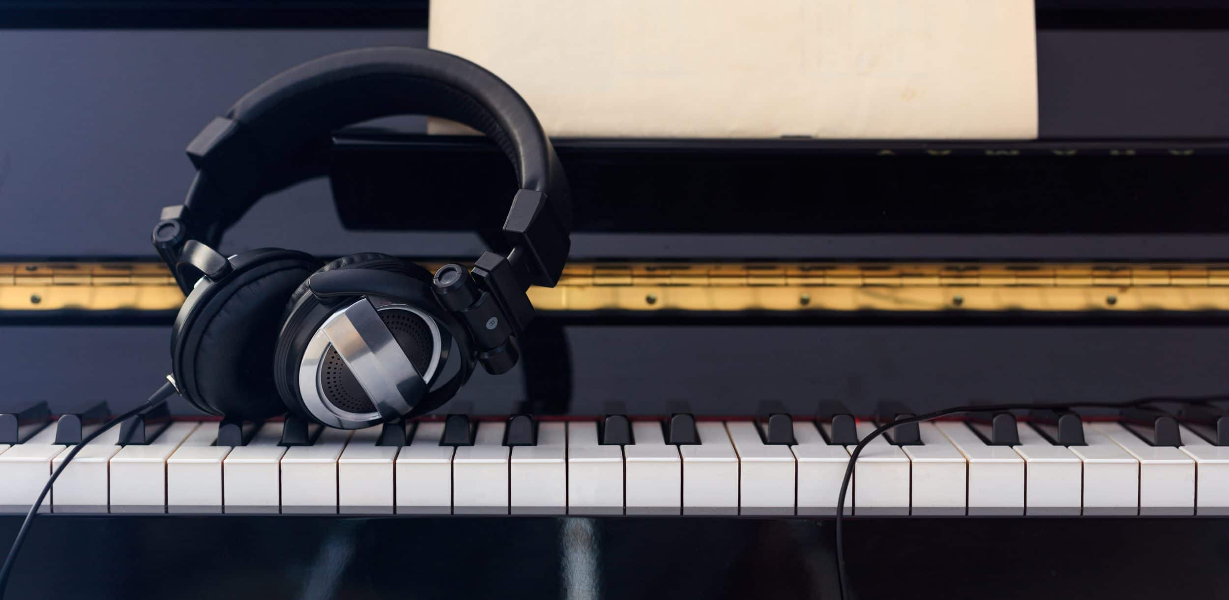 Headphones close up on piano keyboard, front view